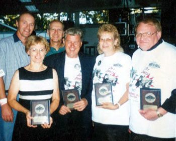 The Do's & Don'ts: Zelda, Dick, Sandy, & Roger with plaques